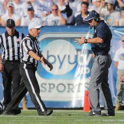 Brigham Young head coach Bronco Mendenhall  argues with the referee after a play as BYU and Virginia to play Saturday, Sept. 20, 2014, at LaVell Edwards Stadium in Provo. BYU won 41-33.