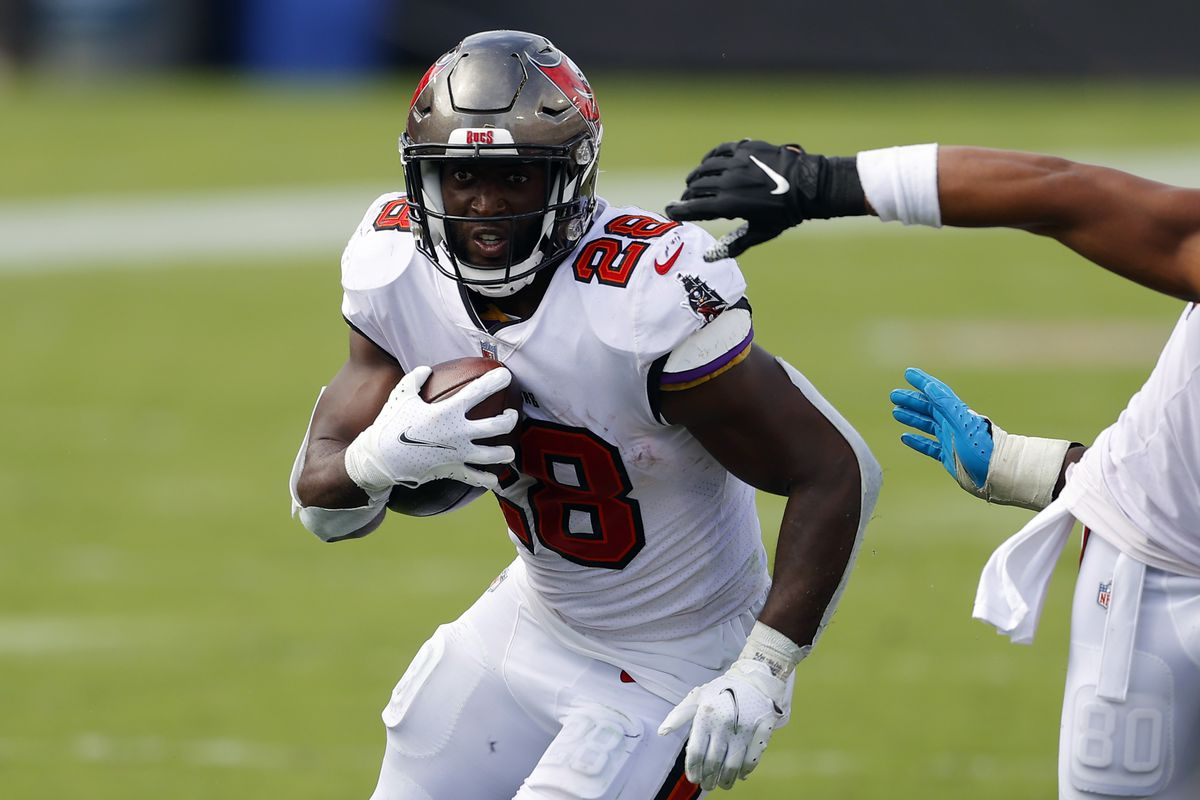 Leonard Fournette #28 of the Tampa Bay Buccaneers runs with the ball during the second half against the Carolina Panthers at Raymond James Stadium on September 20, 2020 in Tampa, Florida.