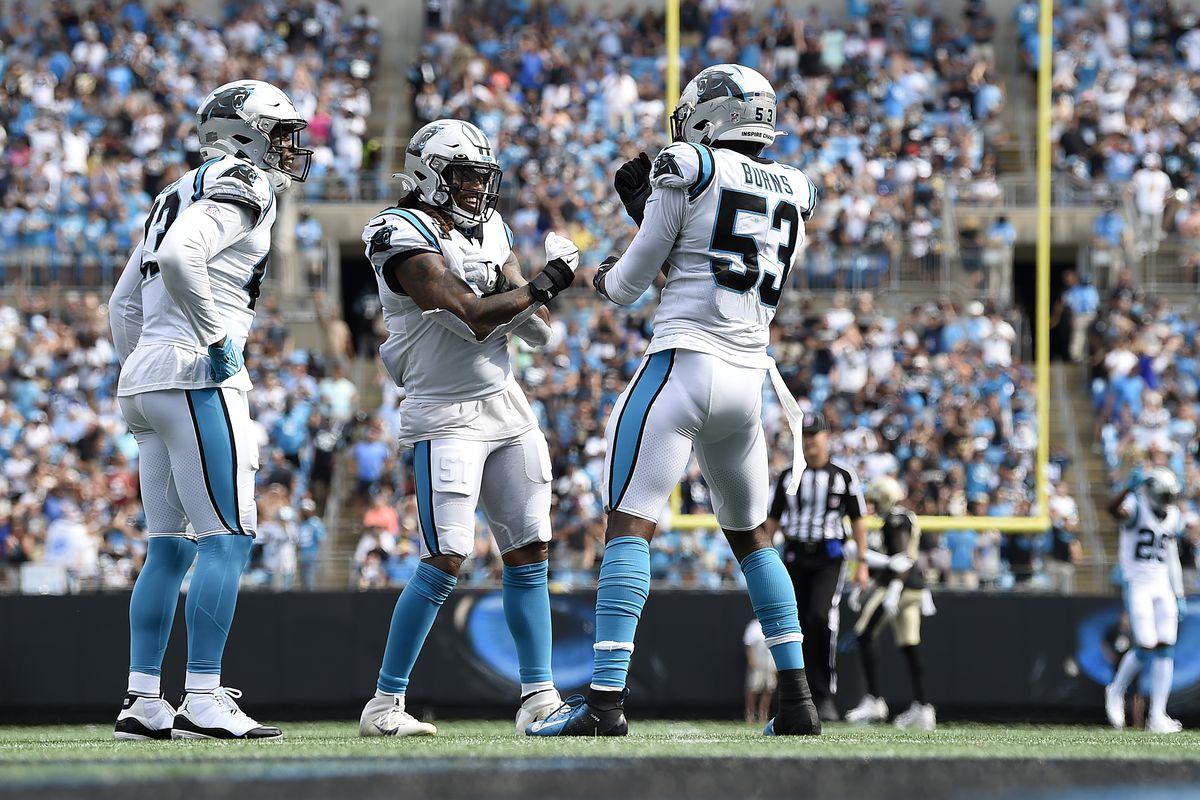 SEPTEMBER 19: Defensive end Brian Burns #53 of the Carolina Panthers celebrates with teammates during the game against the New Orleans Saints at Bank of America Stadium on September 19, 2021 in Charlotte, North Carolina.