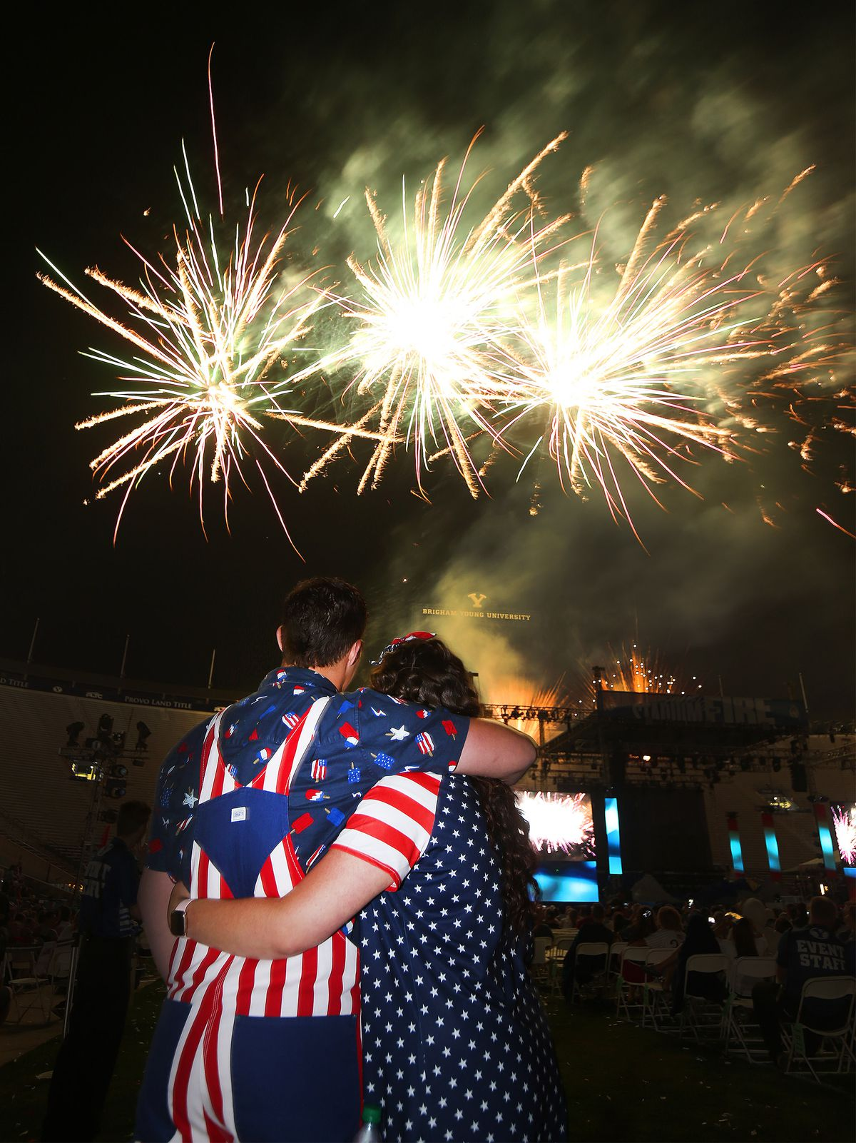 Christian and McKenzie Holden watch the fireworks during Stadium of Fire at LaVell Edwards Stadium in Provo on July 4, 2019.