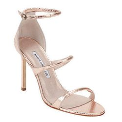 """<a href=""""http://f.curbed.cc/f/Barneys_SP_RNY_053014_Manolo"""">Bombita Rolled-Strap Sandals by Manolo Blahnik</a>"""