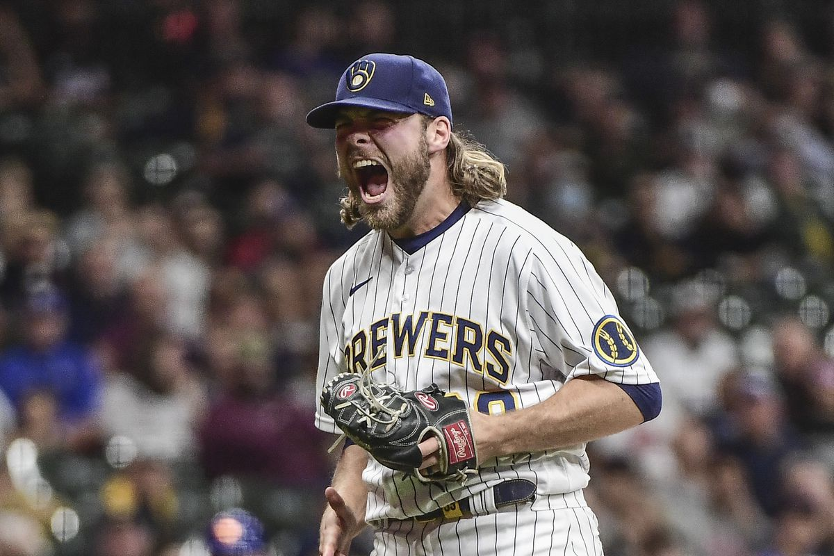 Milwaukee Brewers pitcher Corbin Burnes (39) reacts after retiring the side in the seventh inning during the game against the New York Mets at American Family Field.