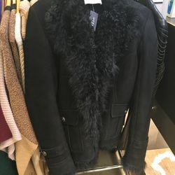 Pierre Balmain shearling coat, $1,500 (was $4,000)