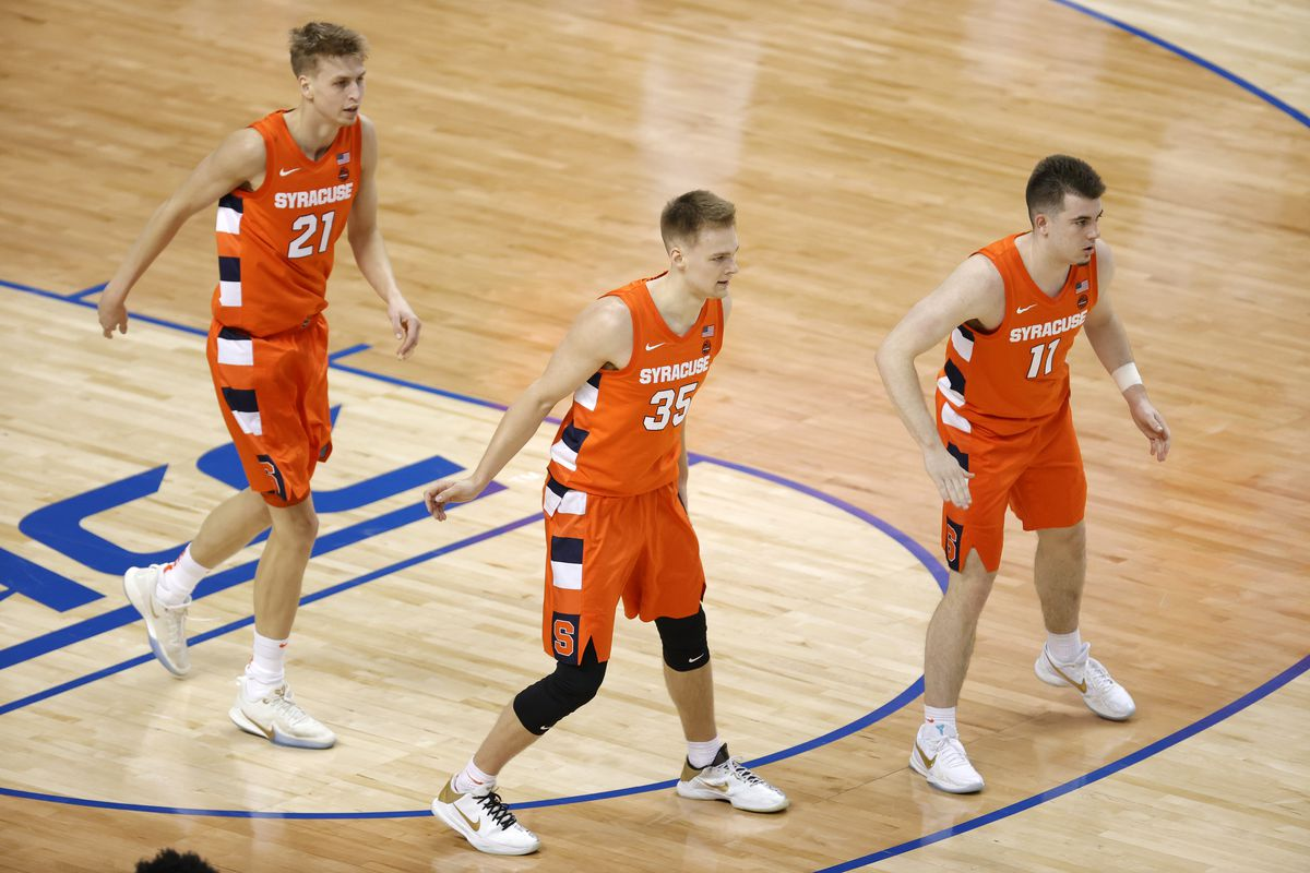 Marek Dolezaj #21, Buddy Boeheim #35, and Joseph Girard III #11 of the Syracuse Orange look on during the first half of their quarterfinals game against the Virginia Cavaliers in the ACC Men's Basketball Tournament at Greensboro Coliseum on March 11, 2021 in Greensboro, North Carolina.