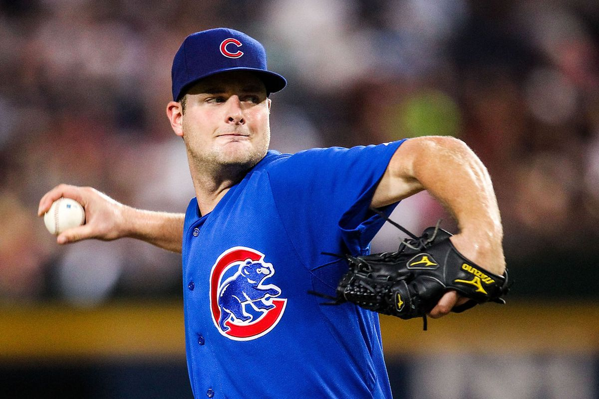 July 3, 2012; Atlanta, GA, USA; Chicago Cubs starting pitcher Chris Volstad (32) pitches in the second inning against the Atlanta Braves at Turner Field. Mandatory Credit: Daniel Shirey-US PRESSWIRE