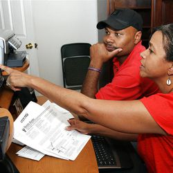 William and Paula Smith prepare their taxes. The Bush tax cuts are set to expire this year.