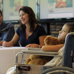 Seven-year-old Sierra Jane Downing from Pagosa Springs, Colo., looks on while her father Sean Downing and mother Darcy Downing talk about her recovery from Bubonic Plague at the Rocky Mountain Hospital for Children at Presbyterian/St. Luke's during a news conference Wednesday, Sept. 5, 2012, in Denver. It is believed Downing caught the Bubonic Plague from burying a dead squirrel.