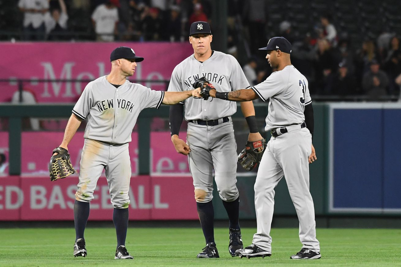 Sabathia leaves with injury; Young rallies Angels past Yanks