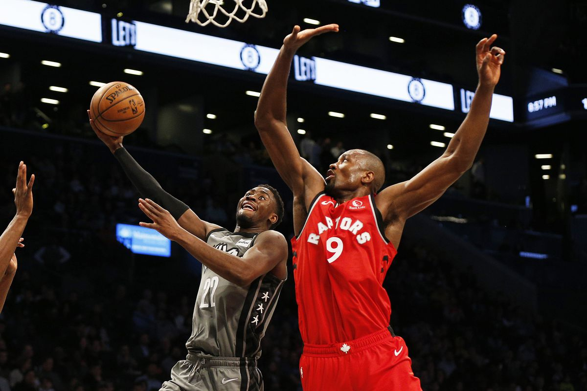 Brooklyn Nets guard Caris LeVert shoots against Toronto Raptors center Serge Ibaka during the second half at Barclays Center.