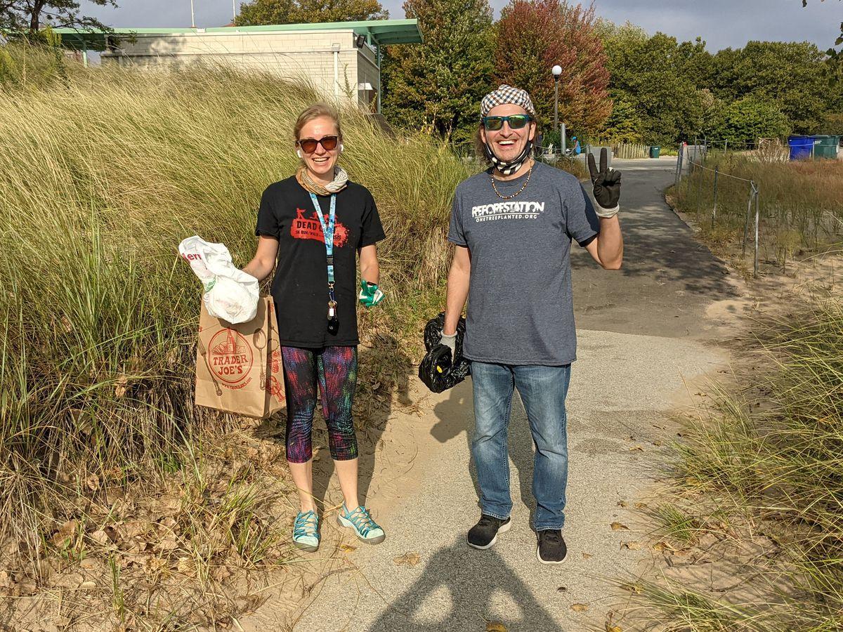 Anna Hendricks and John Jay began their cleanup at the Shore Shore Natural Area Saturday during Adopt-a-Beach. Credit: Dale Bowman