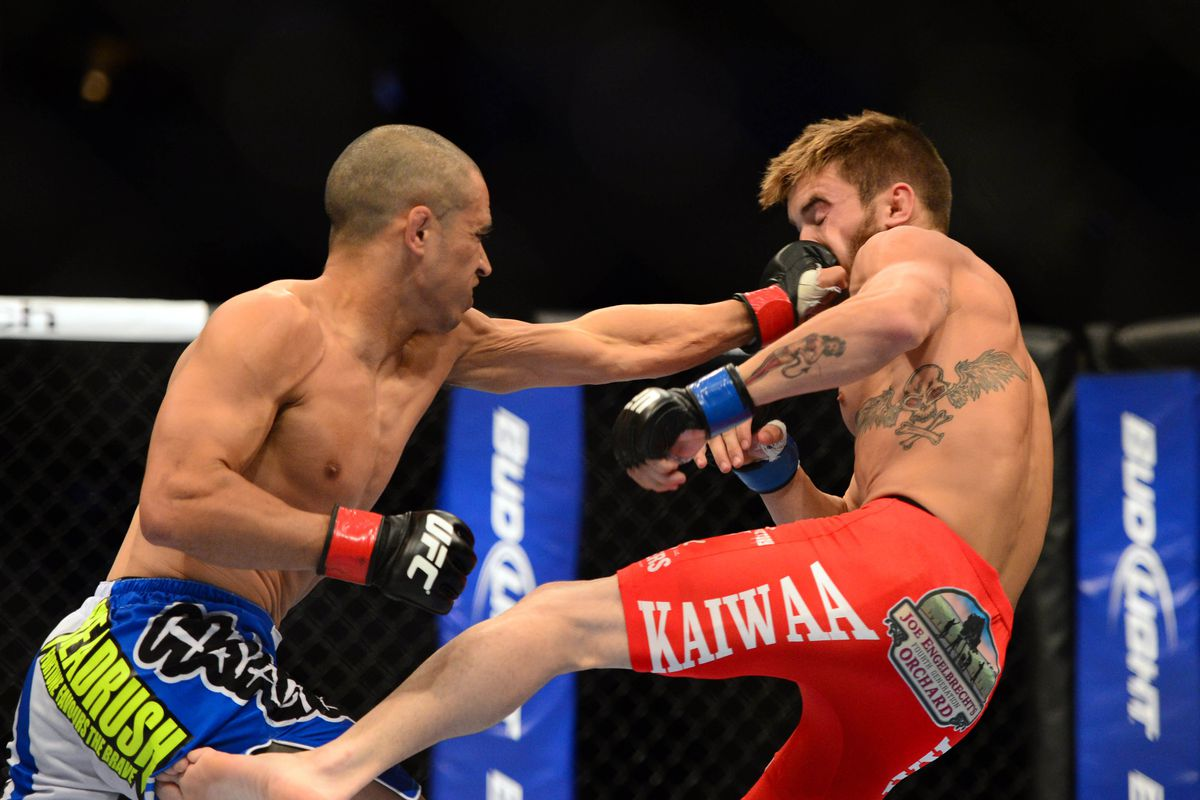 July 11, 2012; San Jose, CA, USA; Chris Cariaso (left) fights Josh Ferguson (right) during the flyweight bout of the UFC on Fuel TV at HP Pavilion. Mandatory Credit: Kyle Terada-US PRESSWIRE