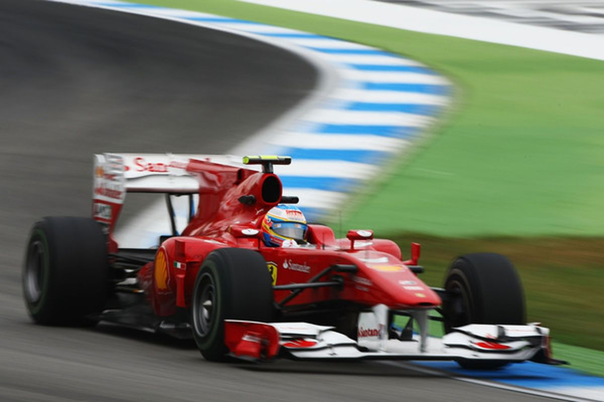 HOCKENHEIM GERMANY - JULY 23:  Fernando Alonso of Spain and Ferrari drives during practice for the German Grand Prix at Hockenheimring on July 23 2010 in Hockenheim Germany.  (Photo by Andrew Hone/Getty Images)