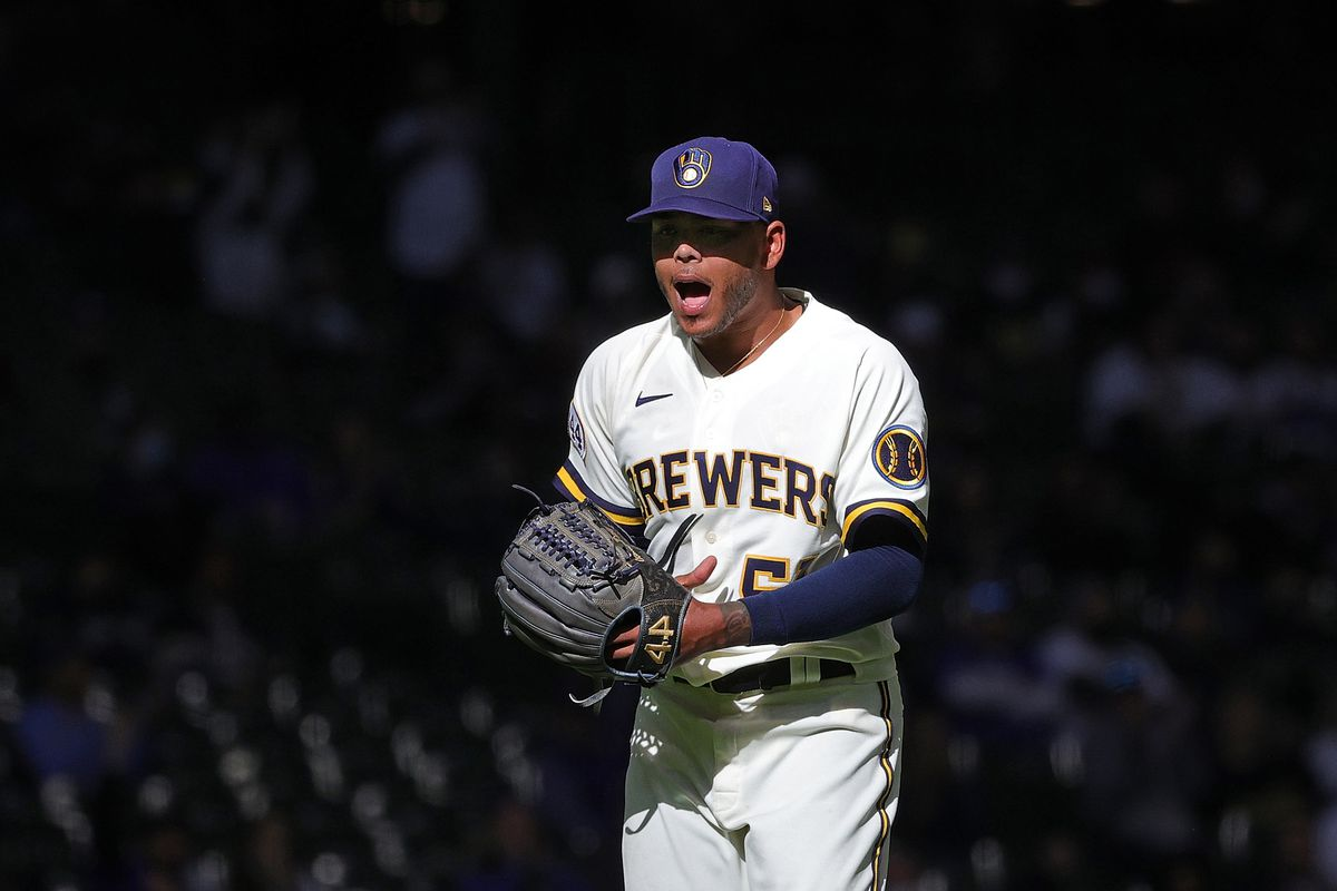 Freddy Peralta #51 of the Milwaukee Brewers reacts to a strike out during a game against the Minnesota Twins on Opening Day at American Family Field on April 01, 2021 in Milwaukee, Wisconsin.