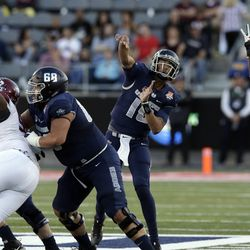 Utah State quarterback Jordan Love (10) throws downfield against New Mexico State in the first half of the Arizona Bowl NCAA college football game Friday, Dec. 29, 2017, in Tucson, Ariz. (AP Photo/Rick Scuteri)