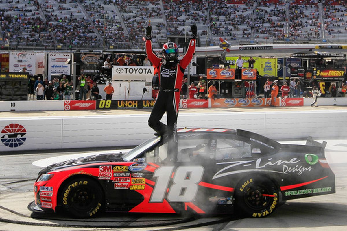 Kyle Busch celebrates after winning the NASCAR Nationwide Series Scotts EZ Seed 300 at Bristol Motor Speedway.