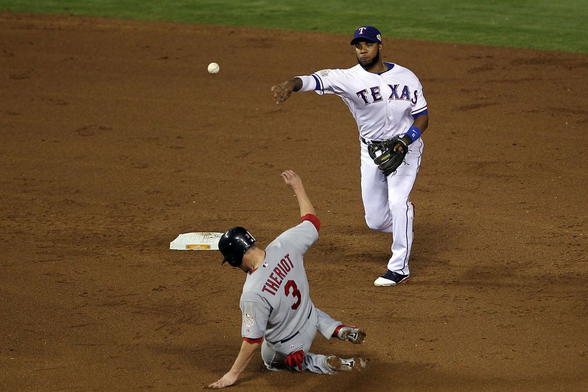Ryan Theriot gets his jersey dirty during the World Series.  (Photo by Ezra Shaw/Getty Images)