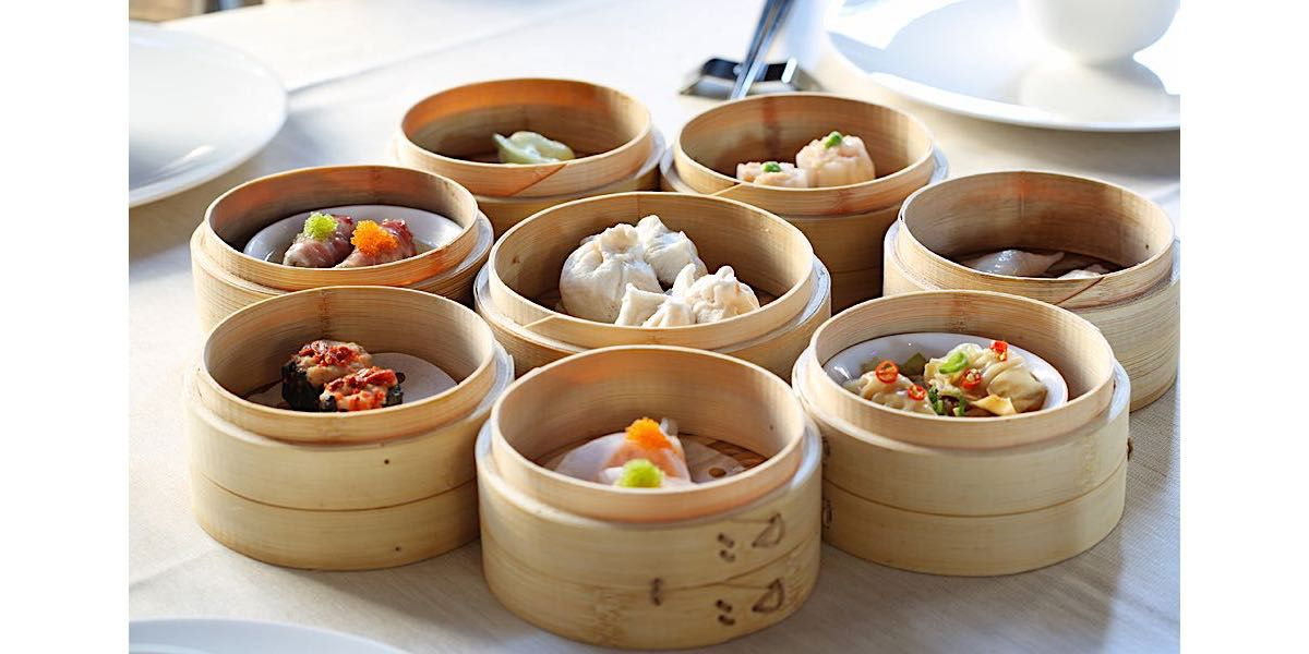 Baskets of dim sum on a table.