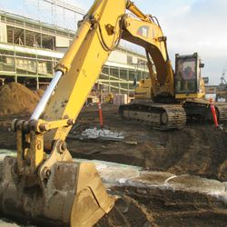 Excavation work in the triangle lot along Waveland