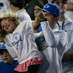 Andrea Spencer, 3, dances with her father Richard Spencer as BYU and Arizona State compete during an NCAA college football game at LaVell Edwards Stadium in Provo on Saturday, Sept. 18, 2021.