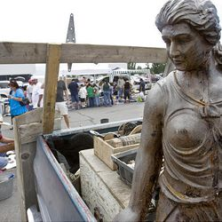 A bronze statue of a woman waits to be sold Sunday at the Swap Meet in West Valley City. The swap meet is held on Saturdays and Sundays.