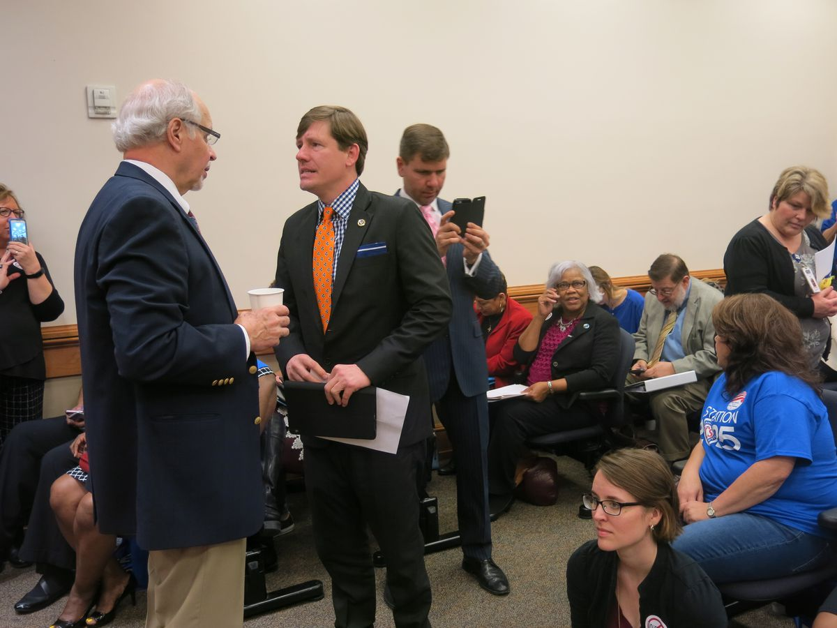 Senate sponsor Brian Kelsey (center) joins the crowd assembling before Tuesday's House committee vote.
