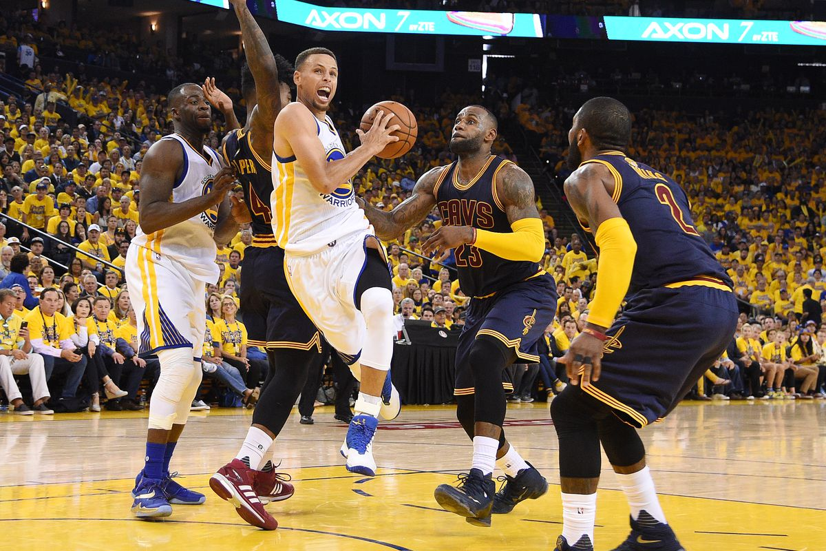 Curry weaves his way through several Cavaliers defenders.