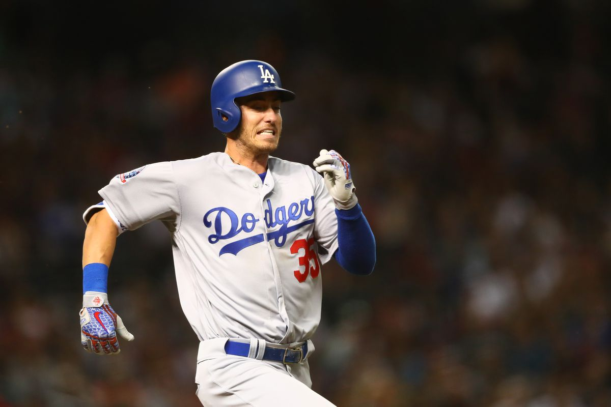 Cody Bellinger runs to first base