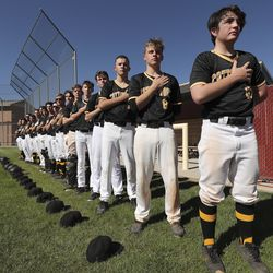 Cottonwood players line up for the National Anthem while they play Maple Mountain during Last Chance Tournament in Spanish Fork on Thursday, May 28, 2020.