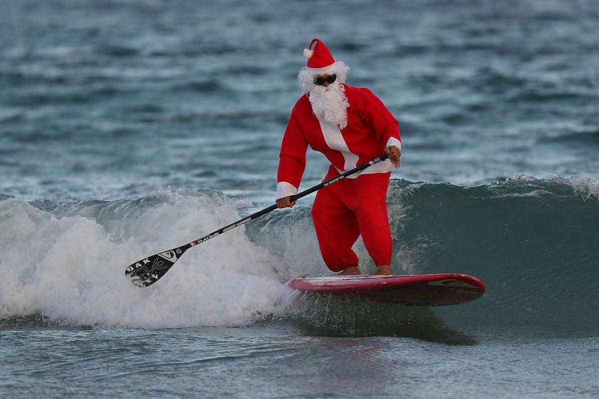 Surfing Santa Enjoys The Waves In Fort Lauderdale