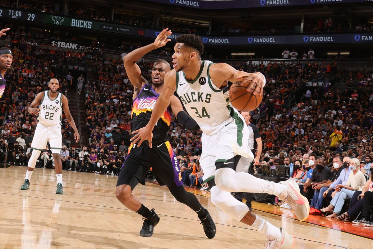 Chris Paul of the Phoenix Suns plays defense on Giannis Antetokounmpo of the Milwaukee Bucks during Game One of the 2021 NBA Finals on July 6, 2021 at Talking Stick Resort Arena in Phoenix, Arizona.