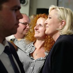 French far-right presidential candidate, Marine Le Pen, right, poses for a selfie with a supporter after the first round of parliamentary elections in Henin Beaumont, Northern France, Sunday, June 11, 2017. France's prime minister is declaring victory for President Emmanuel Macron's new centrist party in the first round of parliamentary elections set to reshape French politics.
