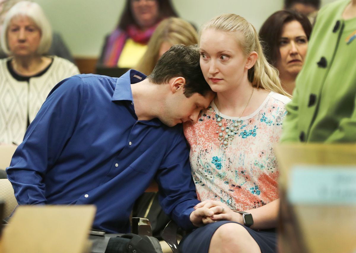 Caleb sits with his wife Julia after both testified during a House Judiciary Committee hearing at the state Capitol in Salt Lake City on Tuesday, March 5, 2019, regarding HB0399, which would ban conversion therapy on minors. Caleb, who asked that his last name not be included, told the committee he went through conversion therapy.