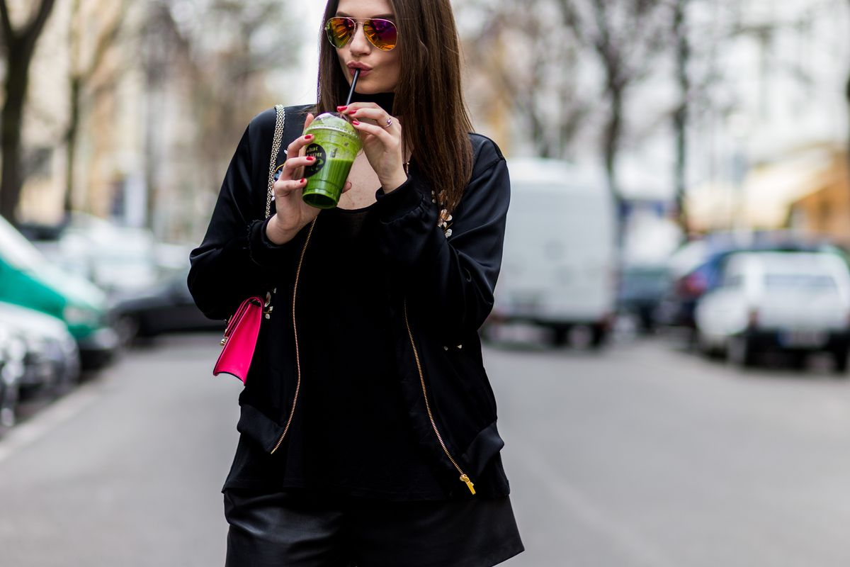 Green juice as street style accessory. Photo: Christian Vierig/Getty Images
