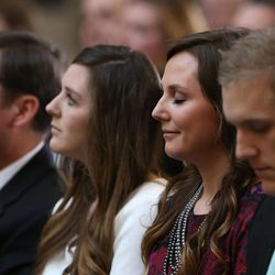 Emily Britton, daughter of former Speaker of the House Rebecca Lockhart, smiles after speaking about her mother at the memorial service for Lockhart in the Capitol rotunda in Salt Lake City on Thursday, Jan. 22, 2015. Lockhart died at her home in Provo on Jan. 17, 2015, from a rare brain disease. Seated with Britton is her father, Stan Lockhart, left, her sister, Hannah Lockhart, and her husband, Max Britton.