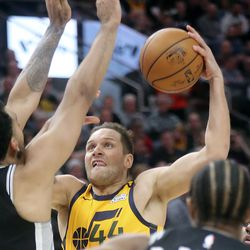 Utah Jazz forward Bojan Bogdanovic (44) shoots as San Antonio Spurs center Trey Lyles (41) guards him during an NBA game at Vivint Arena in Salt Lake City on Friday, Feb. 21, 2020. The Jazz lost 104-113.