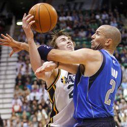 Utah Jazz guard Gordon Hayward (20), left, crashes into Dallas Mavericks guard Jason Kidd (2) in Utah's 123-121 win in triple overtime.