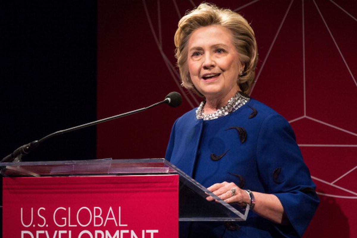 """Hilary Clinton in New York last week wearing the same top she wore yesterday in San Francisco, no scrunchie. Photo via <a href=""""http://gettyimages.com"""">Getty Images.</a>"""