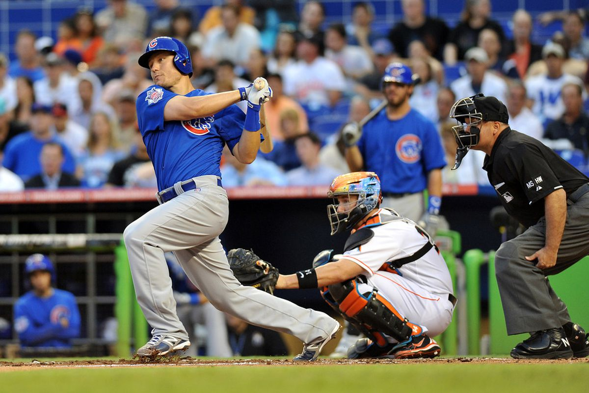 Miami, FL, USA; Chicago Cubs first baseman Jeff Baker connects for a base hit during the second inning against  the Miami Marlins at Marlins Park. Credit: Steve Mitchell-US PRESSWIRE