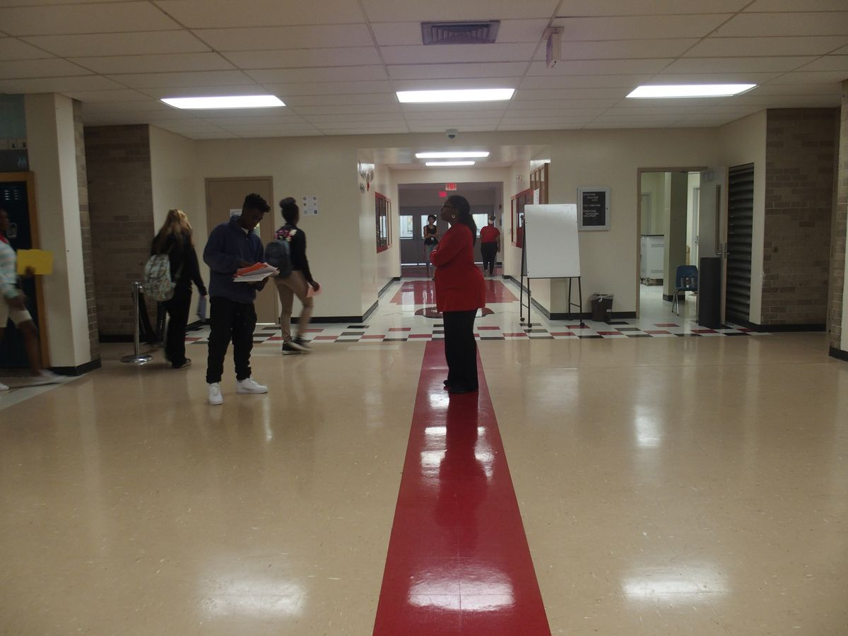 A red line on a hallway floor is designed to separate middle school students from those in upper grades at the newly reconfigured Raleigh-Egypt High School.