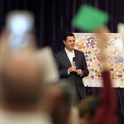 Rep. Jason Chaffetz, R-Utah, listens to questions as many in attendance hold signs and yell during a town hall meeting at Brighton High School in Cottonwood Heights on Thursday, Feb. 9, 2017.