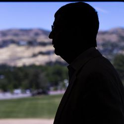 Troy D'Ambrosio, Lassonde Institute executive director, looks out the window of a residential loft in the Lassonde Studios at the sand volleyball courts below on the University of Utah campus in Salt Lake City on Friday, June 23, 2017.