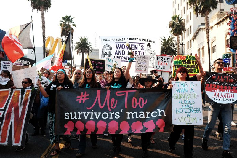 "Activists hold a banner that reads ""#MeToo survivors' march"" in the 2018 #MeToo March."