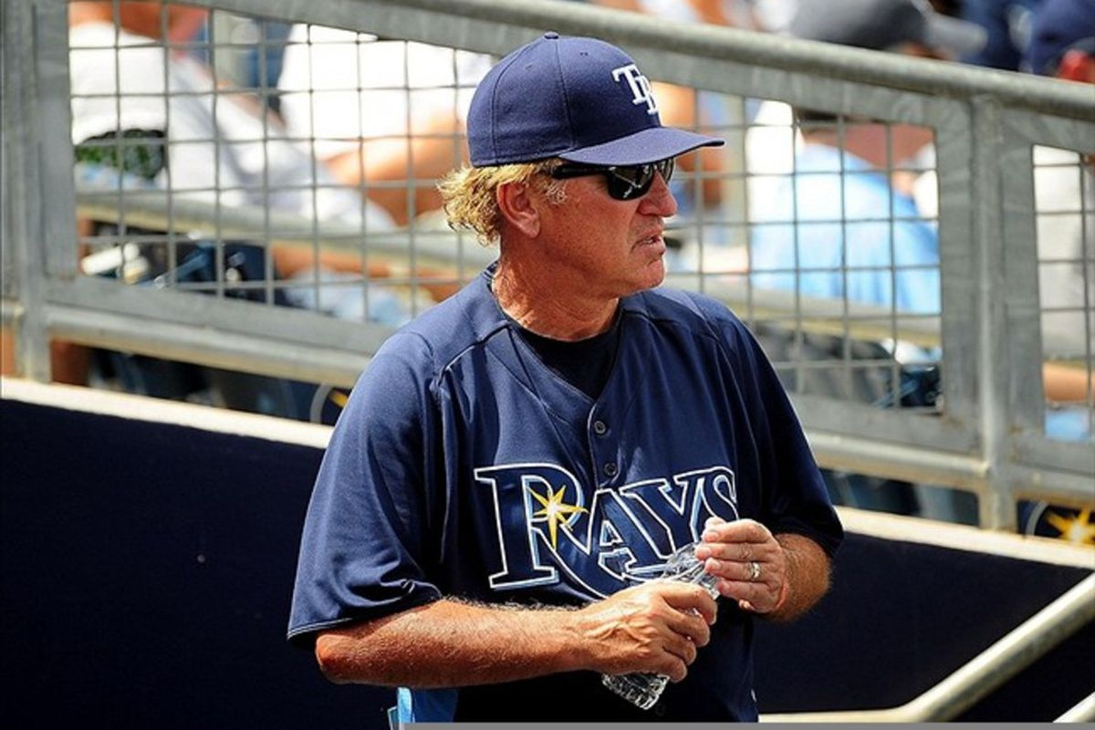 Mar. 14, 2012; Port Charlotte, FL, USA; Tampa Bay Rays manager Joe Maddon (70) in the dugout against the Miami Marlins at Charlotte Sports Park. Mandatory Credit: Andrew Weber-US PRESSWIRE