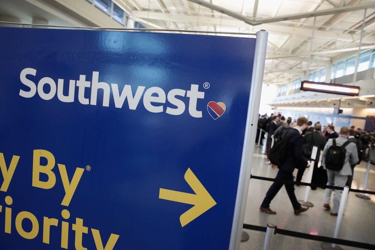 Southwest Airlines passengers check in for flights at Midway Airport in 2018.