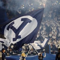 """Brigham Young Cougars mascot Cosmo, waves a giant """"Y"""" flag at the start of the fourth quarter as BYU and USF play a college football game at LaVell Edwards Stadium in Provo on Saturday, Sept. 25, 2021. BYU won 35-27."""