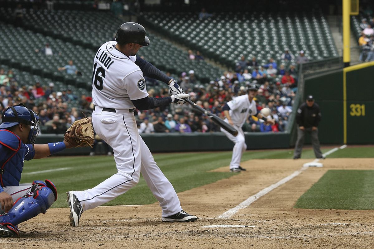 SEATTLE, WA - MAY 23:  Alex Liddi #16 of the Seattle Mariners hits a grand slam against the Texas Rangers at Safeco Field on May 23, 2012 in Seattle, Washington. (Photo by Otto Greule Jr/Getty Images)