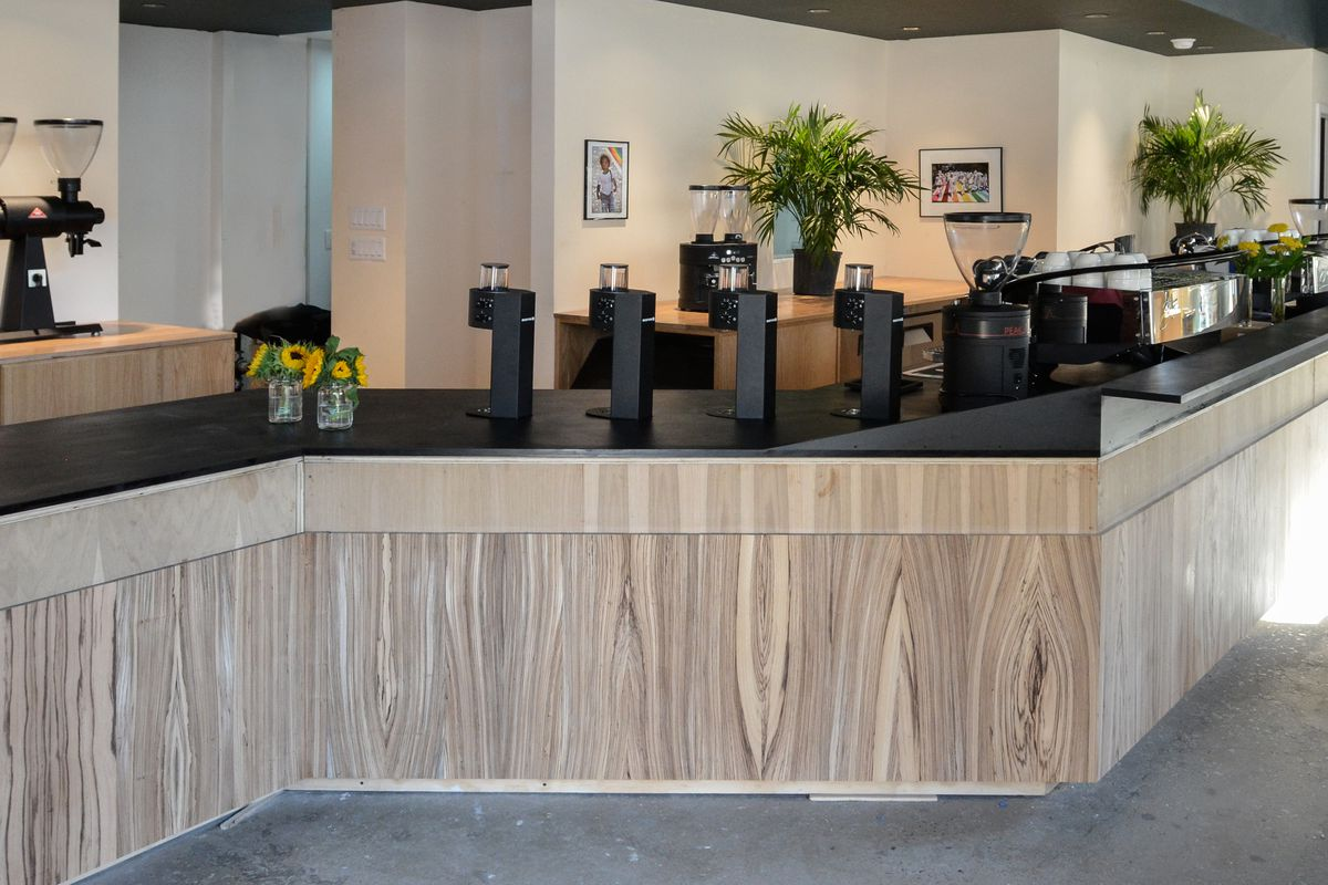 East One Coffee Roasters's bar has a black top