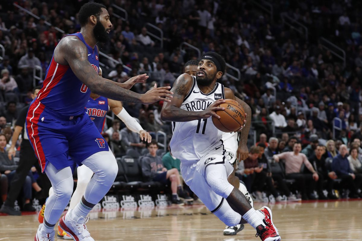 Brooklyn Nets guard Kyrie Irving goes to the basket on Detroit Pistons center Andre Drummond in the second half at Little Caesars Arena.