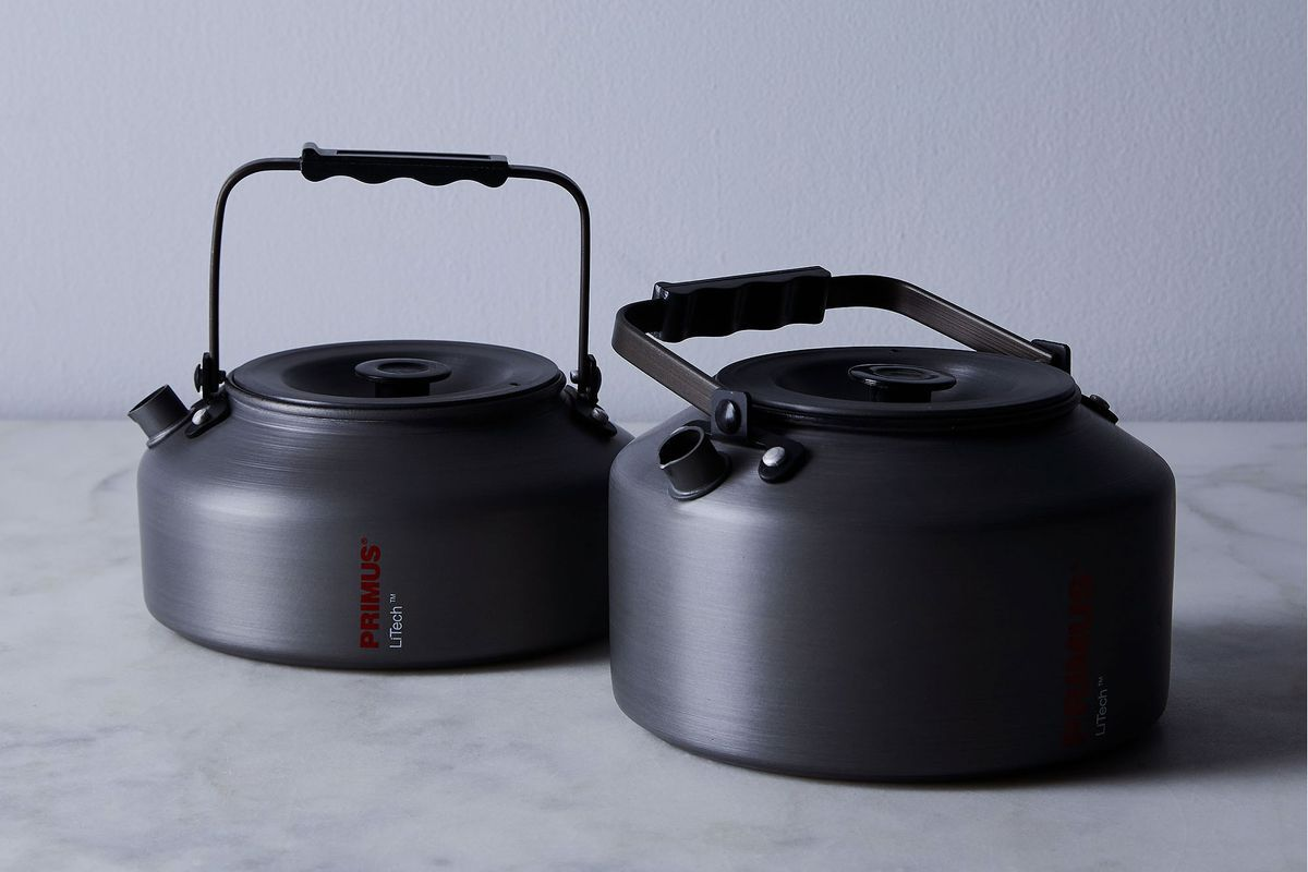 A set of two matching matte black tea kettles