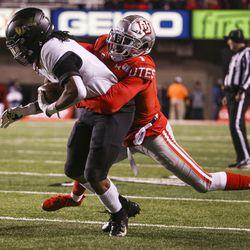 Utah Utes defensive back Jaylon Johnson (1) makes a tackle on Colorado Buffaloes wide receiver Laviska Shenault Jr. (2) during the first half of an NCAA football game at Rice-Eccles Stadium in Salt Lake City on Saturday, Nov. 30, 2019.